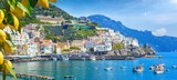 Fototapeta Most - Panoramic view of beautiful Amalfi on hills leading down to coast, Campania, Italy. Amalfi coast is most popular travel and holiday destination in Europe.