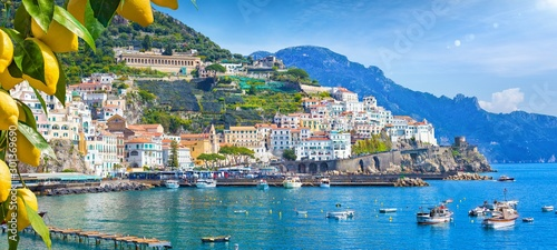 Tuinposter Kust Panoramic view of beautiful Amalfi on hills leading down to coast, Campania, Italy. Amalfi coast is most popular travel and holiday destination in Europe.