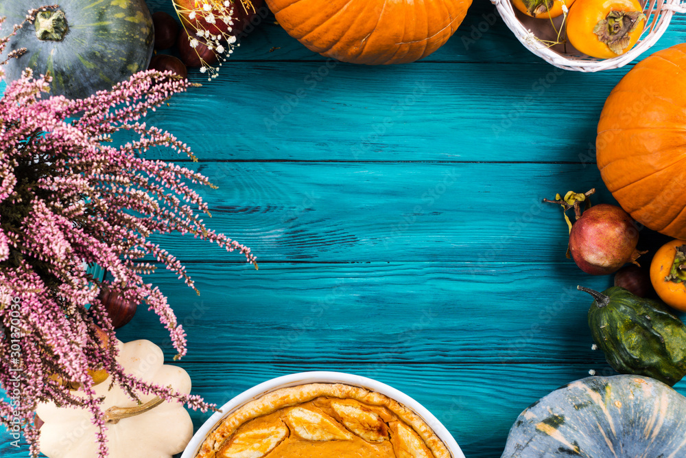 Fototapety, obrazy: Autumn thanksgiving moody background with pumpkin pie, different pumpkins, fall fruit and flowers on green rustic wooden table. Flat lay