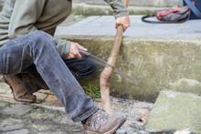 Man With Hand Saw Cutting Bran...