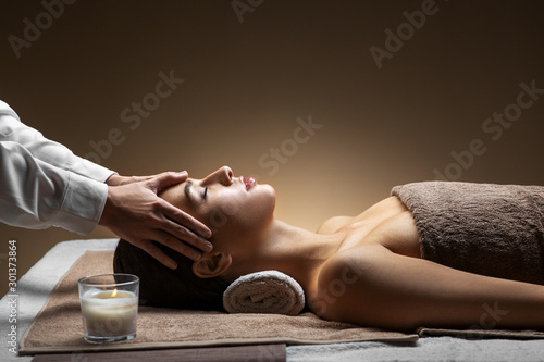 wellness, beauty and relaxation concept - beautiful young woman lying with close Canvas Print