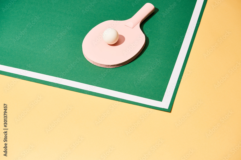 Fototapety, obrazy: Ping pong ball on racket and playing table on yellow surface