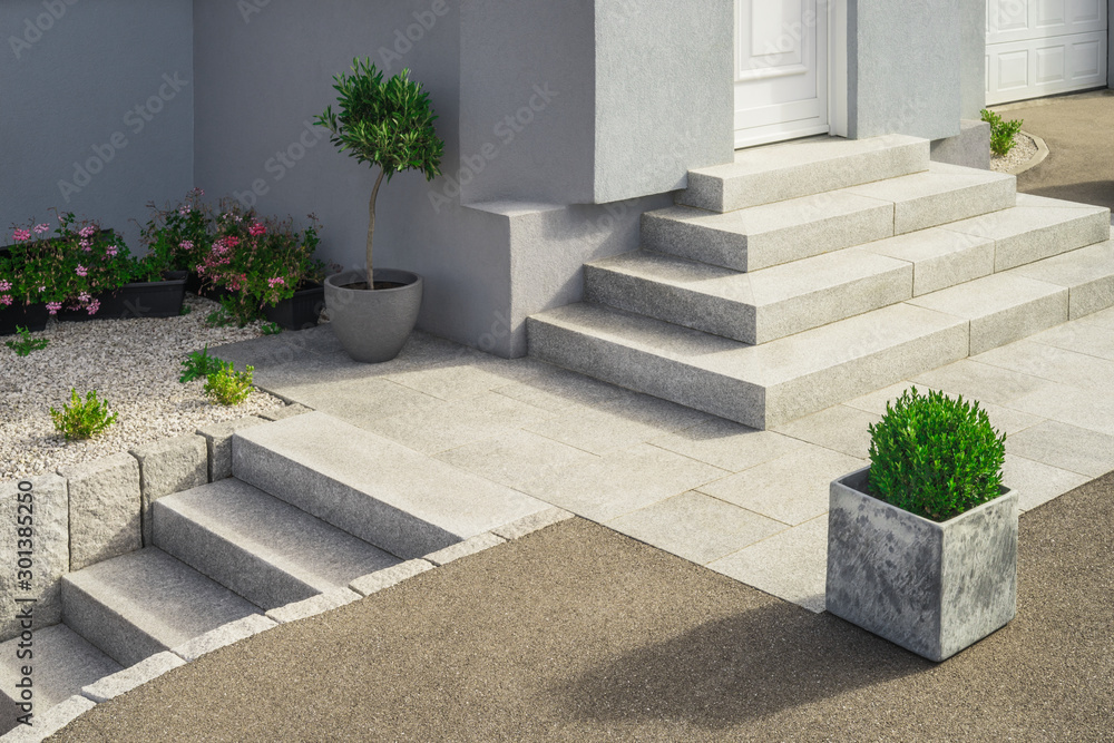 Fototapeta Modern granite external staircases and entrance to a single-family home