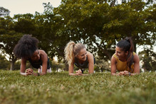 Three Sporty Young Women Smili...