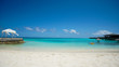 Maldives white sand beach with turquoise water and blue sky