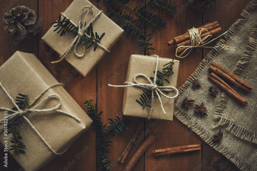 Fototapeta Christmas gifts on wooden boards with decoration, top view
