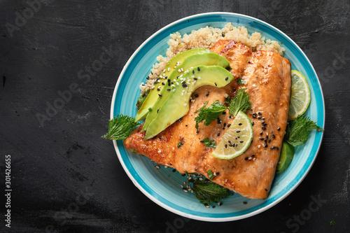 Fototapeta Grilled salmon with avocado, quinoa and sesame obraz