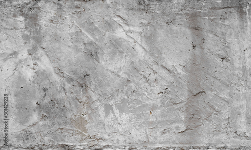Texture of old concrete wall for background. White concrete wall background with a cracks nad holes.