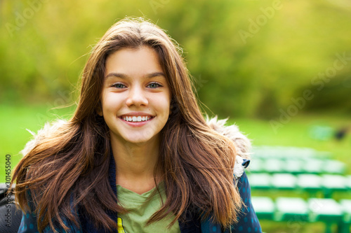 B,runette girl in the background of a summer park Canvas Print