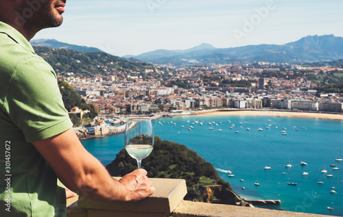Fotografie, Tablou  Drink glass white wine holidays looks top view city coast yacht from observation
