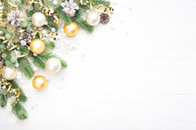Classic Christmas Composition With Fir Branches, White And Golden Baubles, Golden Serpentine And Pine Cones On White Wooden Background. Noel Greeting Card.