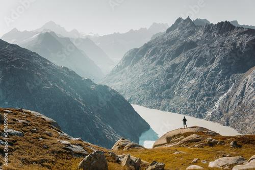 Fototapeta  Man on successful hiking trip, silhouette in mountains of Switzerland