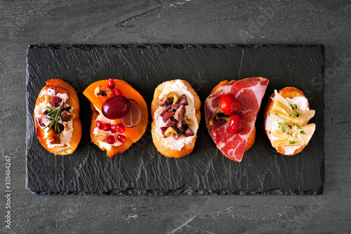 Papel de parede Mixed crostini appetizers with a variety of toppings