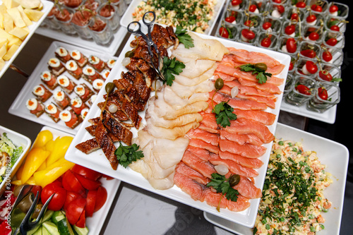 Different types of fish on the banquet table. Canvas Print