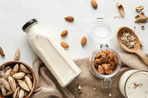 Leinwand Poster Tasty almond milk on white background