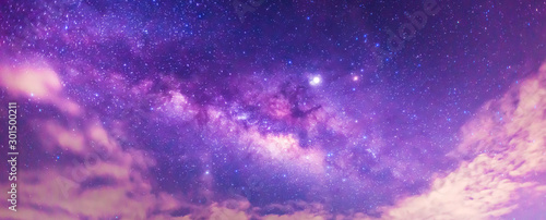 Carta da parati  Panorama blue night sky milky way and star on dark background