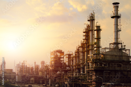 Fototapeta Industrial furnace cracked hydrocarbon in petrochemical business on sunset sky background, Manufacturing of petroleum industrial plant obraz