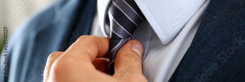 Photo Male arm in blue suit set tie closeup