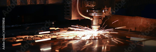 Fototapeta Sparks fly out machine head for metal processing obraz