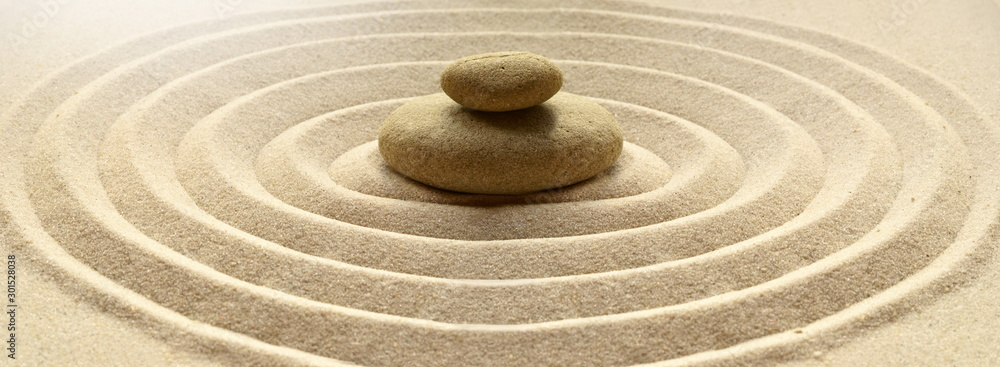Fototapeta zen garden meditation stone background with stones and lines in sand for relaxation balance and harmony spirituality or spa wellness