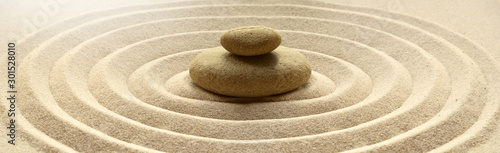 zen garden meditation stone background with stones and lines in sand for relaxat Canvas Print