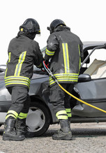 Firefighters Use A Shear To Open The Car Door