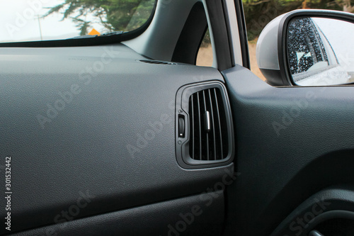 Fotografie, Obraz  Car interior with view of air conditioner vent and side view mirror