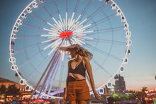 Young Woman Shaking Her Head On A Ferris Wheel