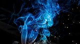Colorful smoke of blue on a black isolated background.