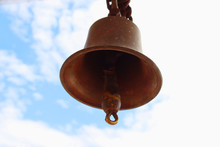 Bell On Blue Sky Background