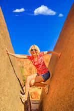 Happy Woman Wedged Balancing B...