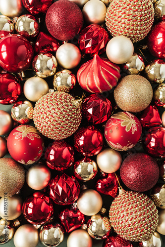 Closeup of red and gold Christmas baubles / balls. Flat lay, top view New Year / Christmas pattern.