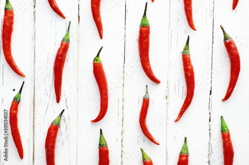 Photo  Hot red pepper on a white wooden vintage background.