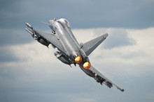 An RAF Typhoon Takes Off Fully Loaded With Weapons On Its Wings To Perform A Display At An Airshow