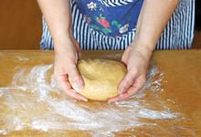 Female Hands Holding A Dough