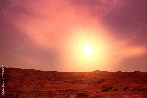 Foto auf AluDibond Violett rot Mountain nature landscape. Desert in the evening. Orange sunset in mountains. View of mountains ridge against a sunset sky. Nature background