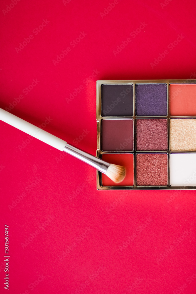 Eyeshadow palette and make-up brush on red background, eye shadows cosmetics product for luxury beauty brand promotion and holiday fashion blog design