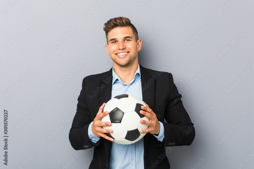 Fototapeta Young soccer trainer happy, smiling and cheerful.