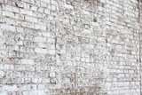 Old wall made of red brick, painted white in loft style for modern designer interior of room, bar or restaurant