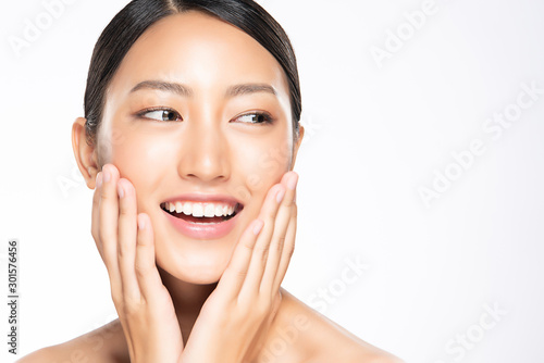 Fotobehang Spa Beautiful young Asian woman touching soft cheek and smile with clean and fresh skin. Happiness and cheerful with, isolated on white background, Beauty and Cosmetics Concept,