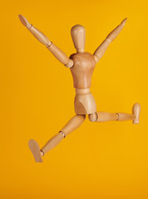 Wooden Man In Jumping Pose