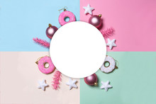 Multicolored Paper Background In Pastel Colors With Christmas Decoration Balls, Donuts And Stars.   Flat Lay, Top View. Christmas Card Conception.