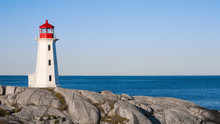 Peggys Cove Lighthouse On A Sunny Day With Blue Sky.