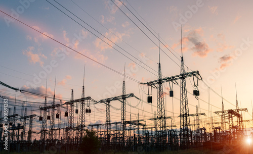 The silhouette of the evening electricity transmission pylon Wallpaper Mural