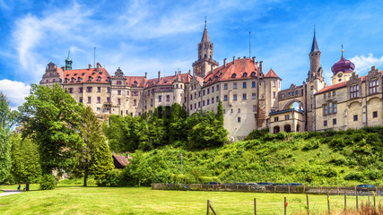 Sigmaringen Castle in summer, Germany. This famous Gothic castle is a landmark of Baden-Wurttemberg. Panorama of old German castle on a hill. Scenic view of beautiful medieval palace on sunny day.