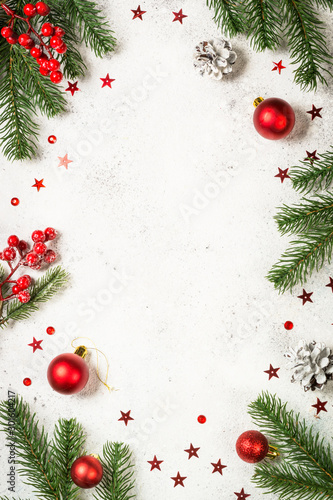 Christmas background with fir tree and decorations on white. - 301604217