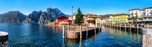 View Of Torbole At The Lakeside Of Lake Garda In Summer In The Northern Italy. Torbole Is A Popular Holiday Location In Italy.