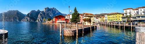 Stampa su Tela View of Torbole at the lakeside of Lake Garda in summer in the northern Italy
