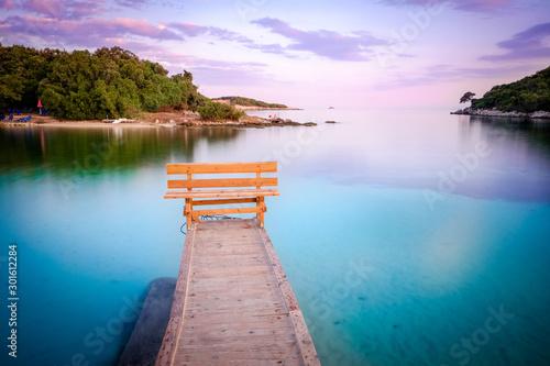 Foto op Plexiglas Purper Wooden Pier In The Sea. Beautiful small paradise island.Ksamil, Butrint National Park, Sarande, Albania