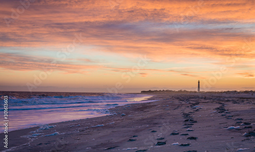 Cape May NJ lighthouse and Atlantic Ocean at sunset in springtime